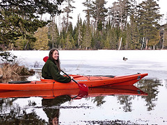 Kaitlin in kayak with ice