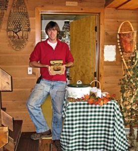 "Andy with ""Taste of the Gunflint Trail"" cookbook on Saturday 9.13"