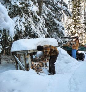 Quinn and Kaitlin work together reloading the cabin wood racks.  We go through an amazing amount of wood each winter.