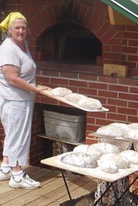 Lesley Gradick baking bread in her wood-fired oven in Grand Marais.